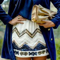 Like the idea of a patterned skirt with a solid top and over coat in the same color