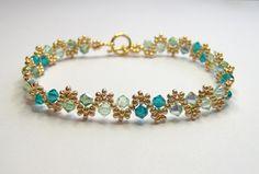 Shades of green swarovski bracelet - green and gold bracelet - bicone bracelet - seed bead bracelet - crystal bracelet - spring bracelet by BuzzybeeBeading on Etsy https://www.etsy.com/listing/174367340/shades-of-green-swarovski-bracelet-green