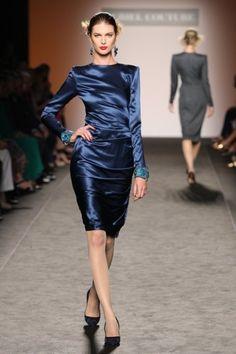 Midnight blue long sleeve satin dress with knee length skirt