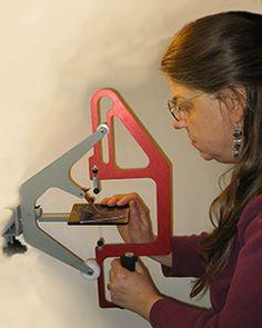 Cynthia using the Blanking Die Precision Saw.