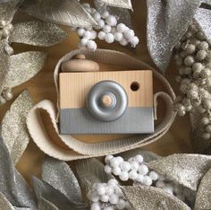Silver handmade wooden camera | So cute and so much fun. It will look great in your home and on your kid.