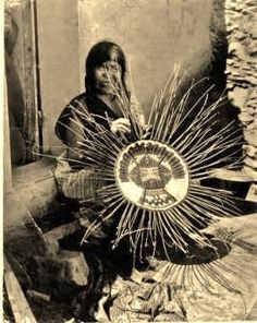 Hopi Indian woman circa 1920. The Hopi are a Native America Nation who primarily live on the 1.5 million acre Hopi Reservation in northeaster Arizona. The reservation is surrounded by the Navajo reservation. Hopis call themselves Hopitu - 'The Peaceful People'.