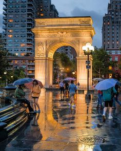 The arch in Washington Square Park glowing in the rain.