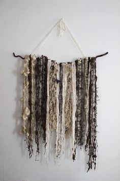 Super textured art yarns are perfect for displaying as wall hangings, and  you can find lots of inspiration for wall weavings on Pinterest. Here is a  very simple wall hanging that I made with remnants of art yarns and yarns  that were too bulky to use in knit or crochet.  MATERIALS:      * A tree branch (mine is about 3 feet long)     * 2 Yards of Sari Silk or other Yarn for Hanging     * 100-150 yards of various handspun and commercial yarns     * Niddy Noddy (optional)  INSTRUCTIONS:  My…