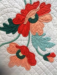 Vintage Poppy Applique Quilt. It has been argued about whether or not to quilt within an applique. I think this beautiful segment addresses that question quite nicely!