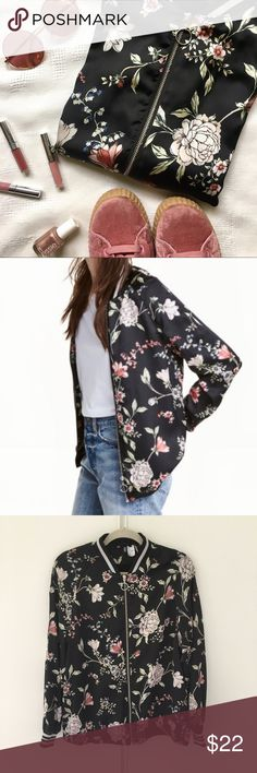 Satin floral bomber jacket In stores now!!!! H&M Divided pink and black silky floral bomber jacket. Black and shimmery silver ribbed cuff and collar. So cute and on trend! Looks great tossed over a tee or tied around the waist. No flaws. Technically a size 10 but I would say it fits like a S/M, but to be fair I feel most comfortable in oversized clothing so who really knows lol H&M Jackets & Coats