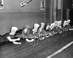 Women who worked in the factories testing the guns they made for the war.