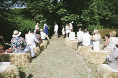 Outdoor wedding ceremony with hay bale seating – photography http://www.petecranston.com/