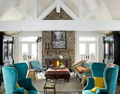 Vaulted two-story living room with stone fireplace.