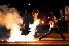 Unrest continued in Ferguson, Mo., after city officials and residents gathered Tuesday evening to try to ease tensions following the shooting death of an unarmed African-American teenager by a police officer. Robert Cohen, St. Louis Post-Dispatch/Associated Press
