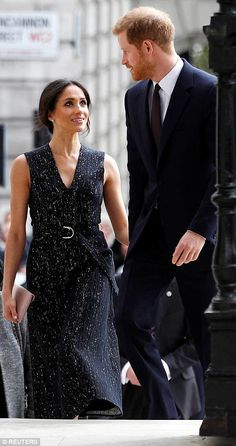 Harry and Meghan arrive at the service...