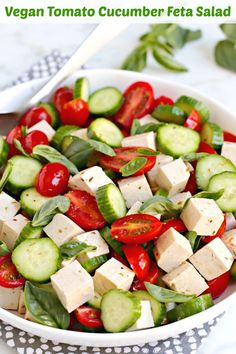 Vegan Tomato Cucumber Feta Salad is a plant-based version of the classic dish. The cubes of feta are actually tofu, making this a high-protein salad. It's the perfect summer recipe when tomatoes, cucumbers, and basil are in season. #vegan #salad #tofu #veganfeta #tomatoes #cucumbers #basil #easy #healthy  via @VeggiesSave