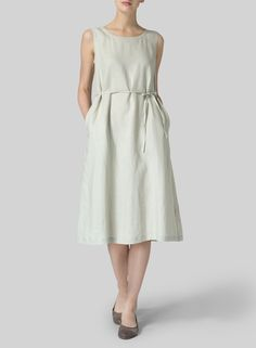 Perfect summer dress- elegant and ladylike; ties at the waist let you play with the silhouette.