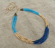 Long multi strand seed bead and chain color block statement necklace. Metallic gold, metallic blue, sparkly montana blue by EntwineArt on Etsy
