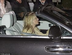 Nice ride! Kate Moss puffed away while driving her brand new £300k Rolls Royce…