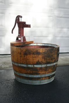 Wine barrel and old fashion water hand pump fountain. Every yard needs a fountain.