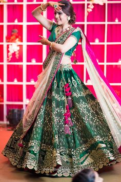 Sangeet / Engagement Lehengas - Bottle Green Lehenga with Golden Embroidery and Fuchsia Pink Detailing | WedMeGood #wedmegood #indianbride #indianwedding #lehengas #bridal #green #indianlehengas #gold #bottlegreen