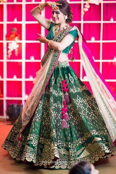 Sangeet / Engagement Lehengas - Bottle Green Lehenga with Golden Embroidery and Fuchsia Pink Detailing | WedMeGood #wedmegood #indianbride #indianwedding #lehengas #bridal #green #indianlehengas #gold #bottlegreen