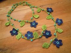 crochet necklace, lariat, blue flowers, green leaves