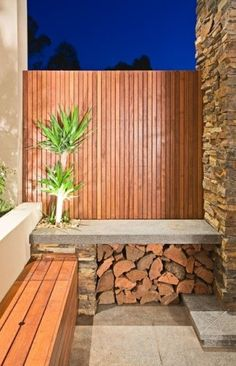 built in seating next to the fireplace with wood storage - very sculptural