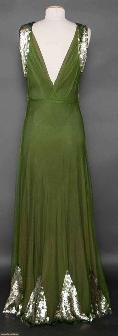 SEQUINED GREEN EVENING GOWN, LATE 1930s (back view) Olive green cotton net, sleeveless, low cut B, wide band of silver sequins for Hi collar, long skirt w/ pattern of sequined triangles at hem, heavy silk bias cut matching underdress