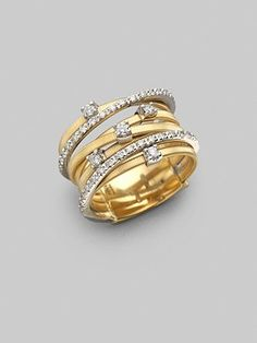 Marco Bicego diamond and 18k gold.  I think this would look really nice on my right hand, since I already have an awesome wedding ring.