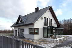 Polish architects Biuro Projektowe MTM STYL have taken a classic family home and turned it into the sweetest little space that you'll ever find. Future House, Double Storey House, Hotel Lounge, Attic Renovation, Dream House Exterior, Facade House, Cottage Homes, Simple House, Modern House Design