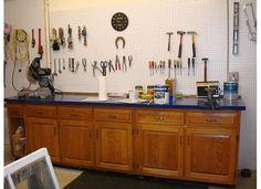 Old kitchen cabinets were used to make garage workshop