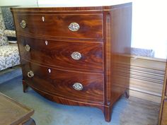 Completely restored Victorian bowfront flame mahogany chest of drawers.