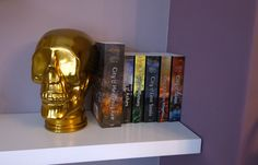 A spooky Glass Skull adds quirky, gothic style to a bookshelf to give a great conversation starter in the home.