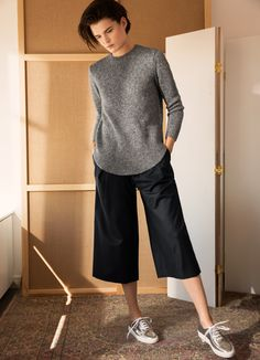 """""""For us, autumn starts with great tailoring and carefully chosen qualities like soft silk, supple leather and fine wool. It sets the mood and highlights our new wardrobe favourites - the pinstripe suit, the pleated skirt and the leather culottes - all styled with skin-baring elements to keep that late summer feel."""" - Julie, our stylist."""