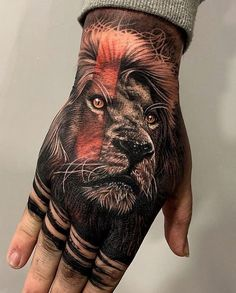 Looking for the best hand tattoos? Hand tattoos for men are bold and rebellious. Because hand tattoos are very visible and painful to get, think twice if you plan on…View Tiger Hand Tattoo, Back Of Hand Tattoos, Hand Tats, Lion Hand Tattoo Men, Back Of Neck Tattoo Men, Wolf Tattoos, Lion Head Tattoos, Animal Tattoos, Body Art Tattoos