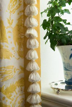 Curtain Detail… tassel trim and contrasting banding on the leading edge. yellow and white print drapery panel