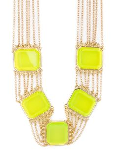 Turn heads in this elegant yet electric style. Crafted from delicate gold chains and oversized neon yellow gems, it's awesomely audacious, too.