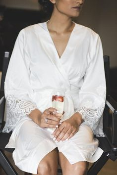 f4794c9997 Homebodii Wedding Bridal Robe. Bride is wearing our Lola White Matte Satin  Kimono Robe with