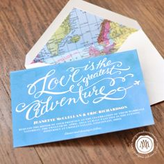 """Travel Theme Calligraphy Wedding Invitation. """"Love is the greatest adventure."""" with map lining. By Margot Madison Creative"""