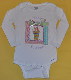 "Infant Girl Easter/Springtime ""Hoppy Easter"" Onesie, Colorful with Decorative Ribbon Bow, Short/Long Sleeve.  Image of a springtime scene on fabric is bonded to a onesie, and lavender fabric paint outlines the image. ""Hoppy Easter"" is painted on with lavender fabric paint. As an added touch, a decorative ribbon bow is firmly attached.  Available in many sizes.  Available in short sleeve and long sleeve.    https://www.etsy.com/listing/124761058/infant-girl-easterspringtime-hoppy"