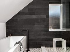 Contemporary bathroom with black framed shower, hex tiles and a ...