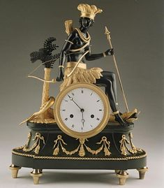 "Pendulum Clock ""au bon Sauvage"" L'Amérique "". France Period: 1799 draft and Directoire Bronze: attr. Jean Simon Deverberie (1784 to 1824). Gilded and patinated bronze eight-day movement with anchor gear, thread suspension of the pendulum, impact on a bell to full-and half-hour."