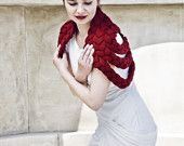 This is The Braided Shrug. This chunky collar/neckwarmer/capelet is no doubt a statement piece. It was meticulously handknitted and then handstitched into this delightfully soft capelet. Now in new color: BURGUNDY.