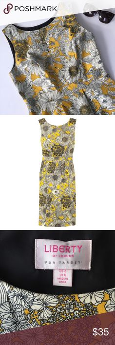 Liberty of London for Target • Yellow sheath dress Adorable sheath dress with yellow sunflower pattern. Designed by Liberty of London for Target. Great for spring and summer weddings or with a blazer at work. Fully lined. Side zip. Center back slit. 98% cotton, 2% spandex. 17 bust, 15 waist, 38 length. Excellent condition. Worn once. Liberty of London for Target Dresses