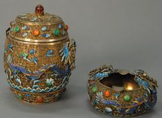 Two Chinese silver filigree and enameled dragon pieces to include a covered box with 2 five claw enameled dragons and jewels and a dragon tray, both marked silver on bottom - Realized Price: $2,520.00