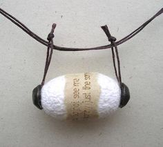 Jo Pond's wrapped cocoon pendant