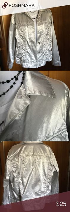 """Chico's Silver metallic jacket size 3 EUC Chico's Silver metallic colored jacket. Button up. Two breast pockets with buttons. Size 3, extra-large. decorative tabs on the bottom band. Material has a crunchy wrinkled look. Armpit to armpit is 23"""". 24"""" sleeves. 23"""" collar to bottom of jacket. 70% cotton 30% polyester can be machine washed and tumble dry on low. Chico's Jackets & Coats"""