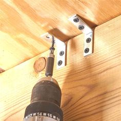 Here's a simple fix for squeaking floor joists: Screw a in. corner bracket to the joist about in. below the subfloor. Then when you drive a screw up into ...