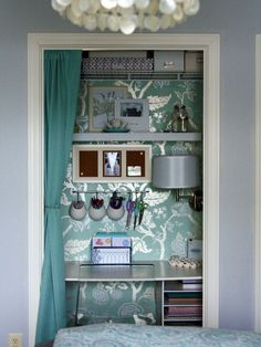 Storage Design, Pictures, Remodel, Decor and Ideas; wallpapered back wall & hideaway curtain are cute - similar to the space I'm furnishing.