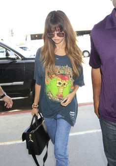 She looks so good! How can Selena make wearing a holey t-shirt look so good? Arriving at LAX July 10, 2016.