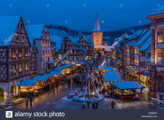 Germany Baden Wurrtemberg Black Forest Gengenbach Christmas market on the village square and Advent calendar on the facade of Stock Photo