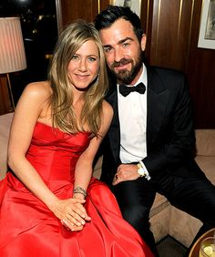 Oscars: Inside the Vanity Fair Party!    Jennifer Aniston traded in her usual little black dress for a bright red Valentino gown, cozying up to her dapper fiance Justin Theroux after the excitement of the Oscars.