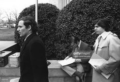 Washington Post Reporters (L) Bob Woodward and (R) Carl Bernstein walk from Federal court after covering the President Richard Nixon Watergate hearings March 1,1974 Washington, DC.
